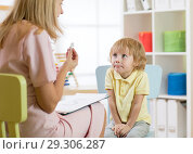 Купить «Cute kid boy at speech therapist office. Private one on one homeschooling.», фото № 29306287, снято 22 октября 2019 г. (c) Оксана Кузьмина / Фотобанк Лори
