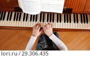 A baby hands playing piano on music lesson in school. Upper angle. Стоковое фото, фотограф Константин Шишкин / Фотобанк Лори