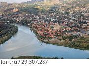Купить «Top view to confluence of Aragvi and Kura rivers, town of Mtskheta and Svetitskhoveli Cathedral», фото № 29307287, снято 23 сентября 2018 г. (c) Юлия Бабкина / Фотобанк Лори