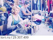 Купить «Two happy women tailors working with sewing machines», фото № 29307499, снято 11 декабря 2018 г. (c) Яков Филимонов / Фотобанк Лори