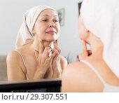 Woman using face cream. Стоковое фото, фотограф Яков Филимонов / Фотобанк Лори