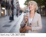 Купить «Adult woman 50s years old is walking in classic dress», фото № 29307695, снято 3 сентября 2017 г. (c) Яков Филимонов / Фотобанк Лори