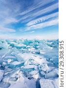 Купить «Field of ice hummocks of transparent blue ice on Siberian Baikal Lake at cold day. Natural winter background», фото № 29308915, снято 9 марта 2013 г. (c) Виктория Катьянова / Фотобанк Лори