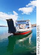 Купить «Baikal Lake. Freight regular passenger ferry arrives from Olkhon Island on a sunny autumn day (translation of the ship's name: Olkhon Gate)», фото № 29309011, снято 14 октября 2018 г. (c) Виктория Катьянова / Фотобанк Лори