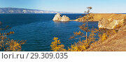 Купить «Lake Baikal. Olkhon Island. Panoramic view of the famous Shaman rock in the autumn sunny afternoon», фото № 29309035, снято 13 октября 2018 г. (c) Виктория Катьянова / Фотобанк Лори