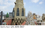 Купить «Magical rooftop of Palau Guell with chimneys and central spire designed by architect Antoni Gaudi», видеоролик № 29309987, снято 2 сентября 2018 г. (c) Яков Филимонов / Фотобанк Лори