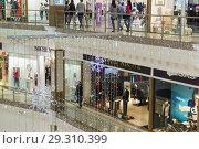 Купить «Russia, Krasnodar-January 07, 2017: shopping and entertainment complex Red Square in new year decoration», фото № 29310399, снято 7 января 2017 г. (c) Наталья Гармашева / Фотобанк Лори