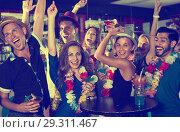 Купить «Company of smiling people on hawaiian party», фото № 29311467, снято 2 августа 2017 г. (c) Яков Филимонов / Фотобанк Лори
