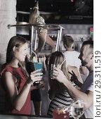 Купить «girl and male clubbing with cocktail», фото № 29311519, снято 28 августа 2017 г. (c) Яков Филимонов / Фотобанк Лори