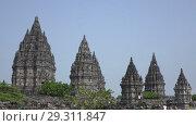 Купить «Candi Prambanan or Candi Rara Jonggrang is an 9th-century Hindu temple compound in Central Java, Indonesia», видеоролик № 29311847, снято 11 октября 2008 г. (c) Куликов Константин / Фотобанк Лори