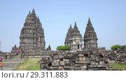Купить «Candi Prambanan or Candi Rara Jonggrang is an 9th-century Hindu temple compound in Central Java, Indonesia», видеоролик № 29311883, снято 11 октября 2008 г. (c) Куликов Константин / Фотобанк Лори