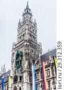 Купить «The clock tower of the new City Hall (Rathaus) in Marienplatz is a famous building in Gothic architecture - Munich, Bavaria, Germany, Europe», фото № 29312359, снято 27 января 2018 г. (c) Николай Коржов / Фотобанк Лори