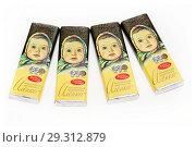 """Купить «Шоколад """"Алёнка"""", четыре маленьких плитки на белом фоне», эксклюзивное фото № 29312879, снято 22 октября 2018 г. (c) Dmitry29 / Фотобанк Лори"""
