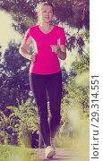Young girl in pink T-shirt is training. Стоковое фото, фотограф Яков Филимонов / Фотобанк Лори