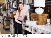 Купить «Female choosing commode in store», фото № 29314775, снято 15 ноября 2017 г. (c) Яков Филимонов / Фотобанк Лори