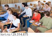 Купить «Portrait of modern young people listening to training session in auditorium», фото № 29314875, снято 26 сентября 2018 г. (c) Яков Филимонов / Фотобанк Лори