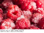 Купить «Fresh frozen red raspberries. Close-up.», фото № 29316027, снято 11 декабря 2018 г. (c) Владимир Пойлов / Фотобанк Лори