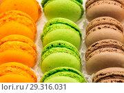Купить «French colorful macarons background, close up», фото № 29316031, снято 2 января 2019 г. (c) Владимир Пойлов / Фотобанк Лори