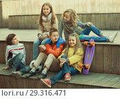 Купить «Group of children portrait with ball and skateboard», фото № 29316471, снято 16 декабря 2018 г. (c) Яков Филимонов / Фотобанк Лори