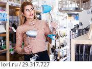 Купить «Housewife buying table lamp», фото № 29317727, снято 15 января 2018 г. (c) Яков Филимонов / Фотобанк Лори