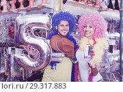 Купить «Family couple preparing for fest and choosing clown wigs», фото № 29317883, снято 11 апреля 2017 г. (c) Яков Филимонов / Фотобанк Лори