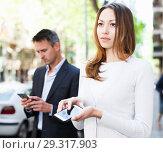 Купить «Young man and woman phubbing», фото № 29317903, снято 11 апреля 2017 г. (c) Яков Филимонов / Фотобанк Лори