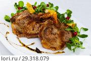 Купить «Tasty cooked fried pork chops with avocado, greens and berries», фото № 29318079, снято 17 июля 2019 г. (c) Яков Филимонов / Фотобанк Лори