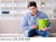 Купить «Sick man suffering at home from infection and bad stomach», фото № 29318439, снято 5 апреля 2017 г. (c) Elnur / Фотобанк Лори