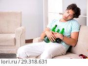 Купить «Young drunk handsome man after party at home», фото № 29318631, снято 9 июля 2018 г. (c) Elnur / Фотобанк Лори