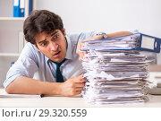 Купить «Overloaded busy employee with too much work and paperwork», фото № 29320559, снято 3 июля 2018 г. (c) Elnur / Фотобанк Лори
