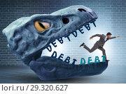 Купить «Businessman in the jaws of debt and loan», фото № 29320627, снято 15 декабря 2018 г. (c) Elnur / Фотобанк Лори