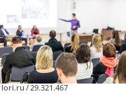 Купить «Business speaker giving a talk at business conference event.», фото № 29321467, снято 16 ноября 2018 г. (c) Matej Kastelic / Фотобанк Лори