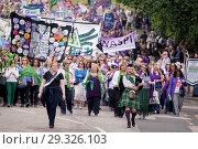 Купить «Thousands of women march through Edinburgh in tribute to 100 years of female suffrage. Processions are taken aprt throughout the country. Featuring: Atmosphere...», фото № 29326103, снято 10 июня 2018 г. (c) age Fotostock / Фотобанк Лори