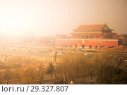 Купить «An aerial bird view of the the famous Forbidden City in Beijing, China. The vast area of the architectural complex», фото № 29327807, снято 14 января 2015 г. (c) Роман Гадицкий / Фотобанк Лори