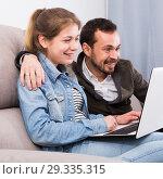 Father and daughter booking online. Стоковое фото, фотограф Яков Филимонов / Фотобанк Лори