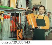 Купить «Glad guy deciding on best garden sprayer», фото № 29335943, снято 2 марта 2017 г. (c) Яков Филимонов / Фотобанк Лори