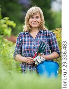 Купить «woman horticultural tools», фото № 29336483, снято 17 июня 2016 г. (c) Яков Филимонов / Фотобанк Лори