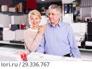 Купить «Mature couple are visiting shop of household appliances for buyi», фото № 29336767, снято 21 ноября 2019 г. (c) Яков Филимонов / Фотобанк Лори
