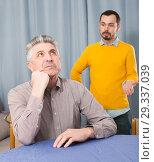 Купить «Son criticizes his mature father», фото № 29337039, снято 23 мая 2019 г. (c) Яков Филимонов / Фотобанк Лори