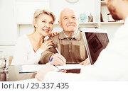 Купить «couple signing papers in bank», фото № 29337435, снято 23 ноября 2019 г. (c) Яков Филимонов / Фотобанк Лори