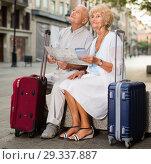 Купить «Traveling mature spouses resting on stone bench on city street», фото № 29337887, снято 27 августа 2017 г. (c) Яков Филимонов / Фотобанк Лори