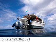 Купить «Diver spend time on surface intervall, Christmas Island, Australia», фото № 29362591, снято 17 декабря 2018 г. (c) age Fotostock / Фотобанк Лори
