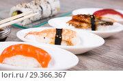 Купить «Nigirisushi on oval saucers and Uramaki», фото № 29366367, снято 25 октября 2016 г. (c) Татьяна Яцевич / Фотобанк Лори