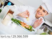 Купить «Portrait of professional cook with shrimps dish», фото № 29366599, снято 19 января 2019 г. (c) Яков Филимонов / Фотобанк Лори