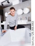 Купить «Portrait of woman buyer choosing ceramic bath in shop», фото № 29366843, снято 2 февраля 2018 г. (c) Яков Филимонов / Фотобанк Лори