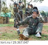 Купить «Paintball player in camouflage with gun», фото № 29367047, снято 22 сентября 2018 г. (c) Яков Филимонов / Фотобанк Лори
