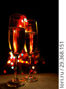 Купить «Two champagne glasses», фото № 29368151, снято 12 февраля 2015 г. (c) Иван Михайлов / Фотобанк Лори