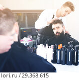 Купить «client feeling discontent about his new haircut at hair salon», фото № 29368615, снято 27 января 2017 г. (c) Яков Филимонов / Фотобанк Лори