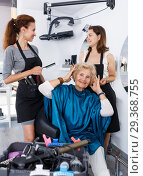 Купить «Hairstylists and satisfied female customer after haircut», фото № 29368755, снято 26 июня 2018 г. (c) Яков Филимонов / Фотобанк Лори