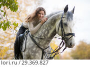 Young woman with a horse. Стоковое фото, фотограф Типляшина Евгения / Фотобанк Лори